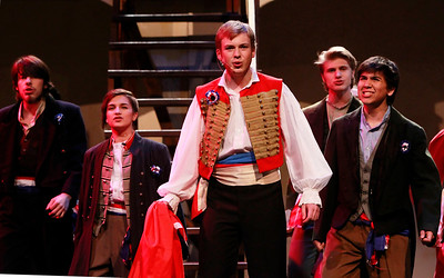 "Candace H. Johnson-For Shaw Media Kurt Meinhardt, as Enjolras, (center) sings,""The ABC Cafe,"" with the Ensemble during the dress rehearsal of Les Miserables at Wauconda High School."