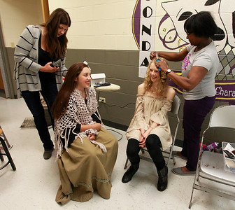 Candace H. Johnson-For Shaw Media Isabelle Esquivel, 16, (Cosette) and Tori Chaffee, 18, (Eponine) get their hair done by Sheri Shaw, of Wauconda and Robbie Davis, of Lakemoor, before the dress rehearsal of Les Miserables at Wauconda High School.