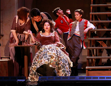 Candace H. Johnson-For Shaw Media Lexi Ellerman, 17, of Wauconda (center) as Madame Thernardier, works with the Ensemble on a song from the Streets of Paris during the dress rehearsal of Les Miserables at Wauconda High School.