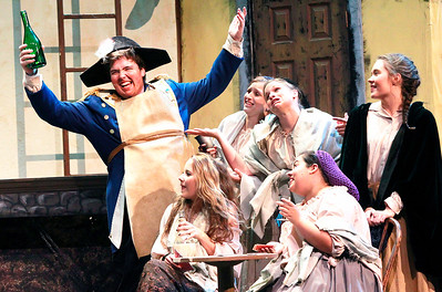Candace H. Johnson-For Shaw Media Ryan Krewer, 17, of Island Lake, as Thenardier, sings with the Ensemble during the dress rehearsal of Les Miserables at Wauconda High School.