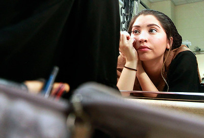 Candace H. Johnson-For Shaw Media Lexi Ellerman, 17, of Wauconda puts her makeup on in her Ensemble costume before the dress rehearsal of Les Miserables at Wauconda High School. Lexi also plays Madame Thenardier in the show.
