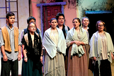 "Candace H. Johnson-For Shaw Media The Ensemble sings the song, ""Do You Hear the People Sing?,"" during the dress rehearsal of Les Miserables at Wauconda High School."