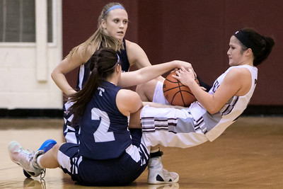 Cary-Grove's Nicollette Richardi (2) and Becca Kendeigh (22) fight for the ball against Prairie Ridge's Lauren Brown (right) in the second quarter Nov. 15, 2016 at Prairie Ridge High School in Prairie Ridge. Cary-Grove goes on to win 59 – 50. KKoontz - for Shaw Media