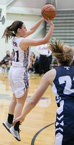 Prairie Ridge's Emily Perhats (21) takes a 3-point shot Nov. 15, 2016 at Prairie Ridge High School in Prairie Ridge. Cary-Grove goes on to win 59 – 50. KKoontz - for Shaw Media