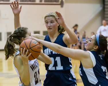 Cary-Grove's Katharine Sowa (21) and Nicollette Richardi (2) play tough defense against Prairie Ridge's Natasha Schaffer (left) Nov. 15, 2016 at Prairie Ridge High School in Prairie Ridge. Cary-Grove goes on to win 59 – 50. KKoontz - for Shaw Media