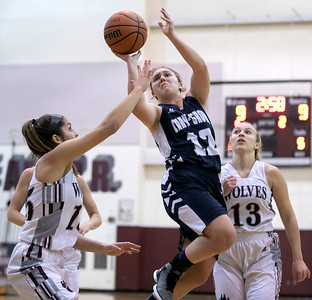 Cary-Grove's Katherine Demert (12) goes up for the shot over Prairie Ridge's Nicole Dorn (15) Nov. 15, 2016 at Prairie Ridge High School in Prairie Ridge. Cary-Grove goes on to win 59 – 50. KKoontz - for Shaw Media