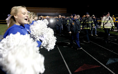 Sarah Nader - snader@shawmedia.com First responders help lead out the Johnsburg football team before Friday's Class 4A semifinal playoff against Phillips Nov. 18, 2016. Johnsburg won in overtime, 23-20.