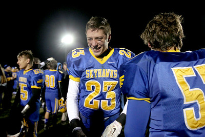 Sarah Nader - snader@shawmedia.com Johnsburg's Brody Frazier celebrates after winning Friday's Class 4A semifinal playoff against Phillips Nov. 18, 2016. Johnsburg won in overtime, 23-20.
