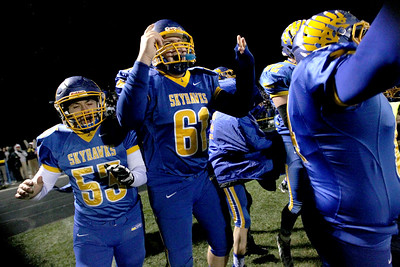 Sarah Nader - snader@shawmedia.com Aubrey Wuchter (left) and Tyler Prouty celebrates after winning Friday's Class 4A semifinal playoff against Phillips Nov. 18, 2016. Johnsburg won in overtime, 23-20.