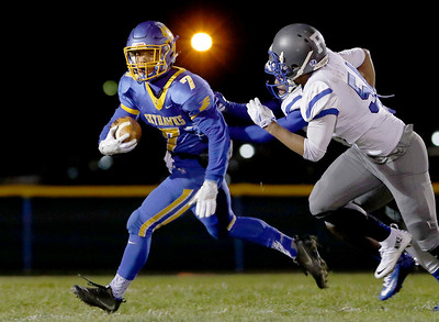 Sarah Nader - snader@shawmedia.com Johnsburg's Alex Peete runs the ball during the first quarter of Friday's Class 4A semifinal playoff against Phillips Nov. 18, 2016. Johnsburg won in overtime, 23-20.
