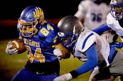 Sarah Nader - snader@shawmedia.com Johnsburg's Nico LoDolce runs the ball during the first quarter of Friday's Class 4A semifinal playoff against Phillips Nov. 18, 2016. Johnsburg won in overtime, 23-20.