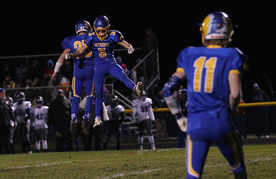 Sarah Nader - snader@shawmedia.com Johnsburg's Austin Butler (left) and Conner Bell celebrate a touchdown during the first quarter of Friday's Class 4A semifinal playoff against Phillips Nov. 18, 2016. Johnsburg won in overtime, 23-20.