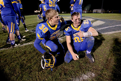 Sarah Nader - snader@shawmedia.com Johnsburg's Austin Butler (right) celebrates after winning Friday's Class 4A semifinal playoff against Phillips Nov. 18, 2016. Johnsburg won in overtime, 23-20.