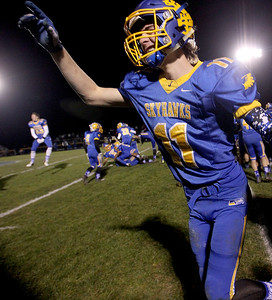 Sarah Nader - snader@shawmedia.com Johnsburg's Joe Calhoun celebrates after winning Friday's Class 4A semifinal playoff against Phillips Nov. 18, 2016. Johnsburg won in overtime, 23-20.