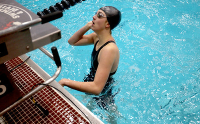 Sarah Nader - snader@shawmedia.com Payton Lange of McHenry looks at her time after competing in the 100-yard freestyle final at the IHSA Girls State Swimming Championships at Evanston Township High School Saturday, Nov. 19, 2016. Lange finished in sixth place.