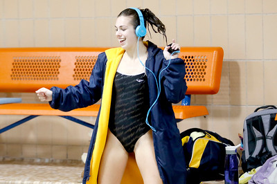 Sarah Nader - snader@shawmedia.com Sterling's Kallie Zuidema pumps herself up in between dives during the diving final at the IHSA Girls State Swimming Championships at Evanston Township High School Saturday, Nov. 19, 2016. Zuidema finished in third place.