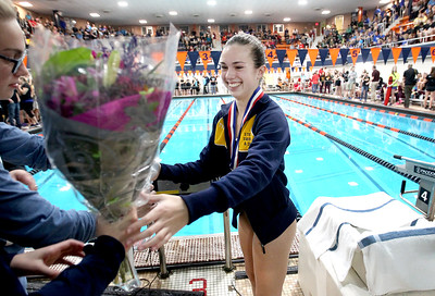 Sarah Nader - snader@shawmedia.com Sterling's Kallie Zuidema receives her metal after competing in the diving final at the IHSA Girls State Swimming Championships at Evanston Township High School Saturday, Nov. 19, 2016. Zuidema finished in third place.