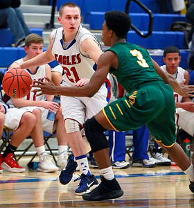 Candace H. Johnson – For Shaw Media Lakes Kyle Rohr looks to drive around Crystal Lake South's Michael Weatherburn in the third quarter during the boys varsity basketball tournament at Johnsburg High School.