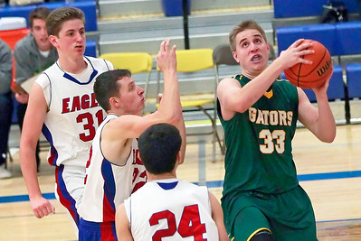 Candace H. Johnson – For Shaw Media Crystal Lake South's Tyler Haskin (#33) looks up for a shot against Lakes defenders Jack Christensen, Logan McCann and Wade Parmly in the third quarter during the boys varsity basketball tournament at Johnsburg High School.