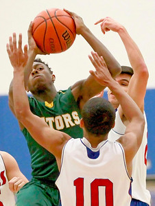 Candace H. Johnson – For Shaw Media Crystal Lake South's Joshua Smith goes up for a shot against Lakes Demetrius Michels in the first quarter during the boys varsity basketball tournament at Johnsburg High School.
