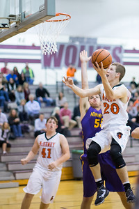 McHenry's Colton Klein (20) goes to the hoop in the fourth quarter against the Hononegah High School defense Monday, Nov. 21, 2016 in the Crystal Lake Central Thanksgiving Tournament held at Prairie Ridge High School in Prairie Ridge. Hononegah held on to win 54-52. KKoontz for Shaw Media