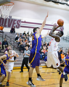 McHenry's Maki Mohr (11) sinks the shot over Hononegah's Spencer Murdoch (55) Monday, Nov. 21, 2016 in the Crystal Lake Central Thanksgiving Tournament held at Prairie Ridge High School in Prairie Ridge. Hononegah held on to win 54-52.  KKoontz for Shaw Media