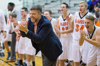 McHenry's head basketball coach, Tim Paddock, and his players celebrate the Warriors tying the game against Hononegah late in the fourth quarter Monday, Nov. 21, 2016 in the Crystal Lake Central Thanksgiving Tournament held at Prairie Ridge High School in Prairie Ridge. Hononegah held on to win 54-52.  KKoontz for Shaw Media
