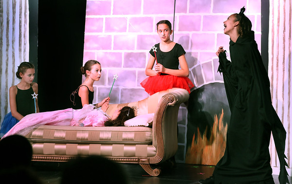 Left to right: Taylor Ditsworth plays Merryweather, Marissa Calusinski plays Fauna, Grace Cerrone plays Flora and Amanda Otten plays Maleficent during Marquee Youth Stage's presentation of Sleeping Beauty in St. Charles on Nov. 19. In bed is Becca Spezzano who plays Aurora.