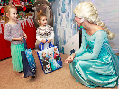 Candace H. Johnson-For Shaw Media Riley Morken, 5, of Antioch and her sister, Chloe, 3, talk to Elsa at Santa's Frozen Village in downtown Antioch.