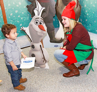 Candace H. Johnson-For Shaw Media John Garelli, 2, of Volo visits with Elf, Jenny Dannemiller, of Columbus, Ohio, at Santa's Frozen Village in downtown Antioch.