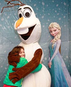 Candace H. Johnson-For Shaw Media Leila Lucas, 6, of Trevor, Wis., gives Olaf a hug at Santa's Frozen Village in downtown Antioch.