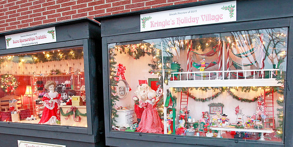 Candace H. Johnson-For Shaw Media Kringle's Holiday Village, which are oversized shadow boxes, sit close to Santa's Enchanted Village in downtown Antioch.