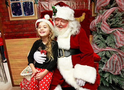 Candace H. Johnson-For Shaw Media Jadalyn Tatgenhorst, 7, of Spring Grove talks to Santa at Santa's Frozen Village in downtown Antioch.