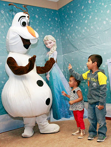 Candace H. Johnson-For Shaw Media Charlie Brown, 2, of Kenosha, Wis., and her brother, Jayden Rosales, 5, wave goodbye to Olaf after visiting with him at Santa's Frozen Village in downtown Antioch.