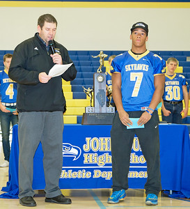 Johnsburg senior Alex Peete (right) is recognized for rushing for over 6000 yards in his four years at Johnsburg High School ranking him eighth on the all-time rushing list in the state of Illinois. The school held a celebration ceremony Monday Nov. 28, 2016 at the high school recognizing the team's second place finish in the Class 4A State Championship. KKoontz – for Shaw Media