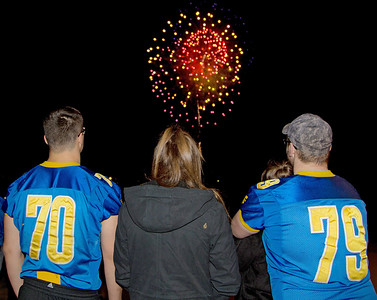 Johnsburg's Joe Moore (70) and Dylan Hess (79) enjoy fireworks with family and friends Monday Nov. 28, 2016 at the Johnsburg State Celebration held at Johnsburg High School in Johnsburg. Johnsburg went 14-1 on the season with their only loss coming in the championship game to Rochester.  KKoontz- for Shaw Media