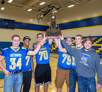 Johnsburg Football Team Captains (Left) Bryce Smith, Alex Peete, Joe Moore, Dyllan Hess, Riley Buchanan, and Blake Lemcke raise the Class 4A State Runner-up trophy Monday Nov. 28, 2016 at the Johnsburg State Celebration held at Johnsburg High School in Johnsburg. Johnsburg went 14-1 on the season with their only loss coming in the championship game to Rochester.  KKoontz- for Shaw Media