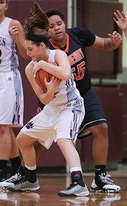 Emily Perhats (21) of Prairie Ridge grabs a rebounds as Avalon Henderson (55) of McHenry defends during the second quarter of their game at Prairie Ridge High School on Tuesday, November 29, 2016 in Crystal Lake. The Warriors defeated the Wolves 49-38.  John Konstantaras photo for the Northwest Herald
