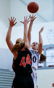 Karly Statter (10) of Prairie Ridge shoots over Elizabeth Alsot (44) of McHenry during the first quarter of their game at Prairie Ridge High School on Tuesday, November 29, 2016 in Crystal Lake. The Warriors defeated the Wolves 49-38.  John Konstantaras photo for the Northwest Herald