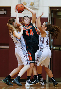 Elizabeth Alsot (44) of McHenry looks to pass as she is pressured by Prairie Ridge defenders during the fourth quarter of their game at Prairie Ridge High School on Tuesday, November 29, 2016 in Crystal Lake. The Warriors defeated the Wolves 49-38.  John Konstantaras photo for the Northwest Herald