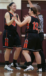 Elizabeth Alsot (44) of McHenry and Madi Kaempf (13) during the first quarter of their game against Prairie Ridge on Tuesday, November 29, 2016 in Crystal Lake. The Warriors defeated the Wolves 49-38.  John Konstantaras photo for the Northwest Herald
