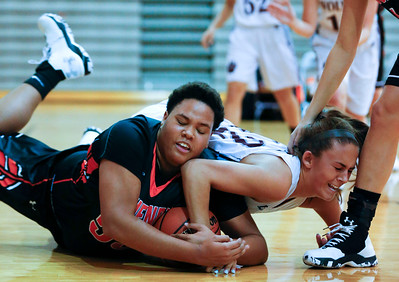 Avalon Henderson (55) of McHenry and Bailey Gorman (42) of Prairie Ridge fight for a loose ball during the second quarter of their game at Prairie Ridge High School on Tuesday, November 29, 2016 in Crystal Lake. The Warriors defeated the Wolves 49-38.  John Konstantaras photo for the Northwest Herald  hspts_wed1130_mch_pri_gbk