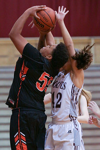 Avalon Henderson (55) of McHenry puts up a shot as Bailey Gorman (42) of Prairie Ridge defends during the third quarter of their game at Prairie Ridge High School on Tuesday, November 29, 2016 in Crystal Lake. The Warriors defeated the Wolves 49-38.  John Konstantaras photo for the Northwest Herald