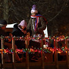 People board a tractor-pulled wagon during the Celebration of Lights Festival on the Batavia Riverwalk on Nov. 27.