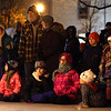 A crowd watches the Batavia Community Band perform during the Celebration of Lights Festival on the Batavia Riverwalk on Nov. 27.