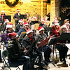 The Batavia Community Band performs during the Celebration of Lights Festival on the Batavia Riverwalk on Nov. 27.