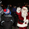 Santa Claus greets residents during the Celebration of Lights Festival on the Batavia Riverwalk on Nov. 27.