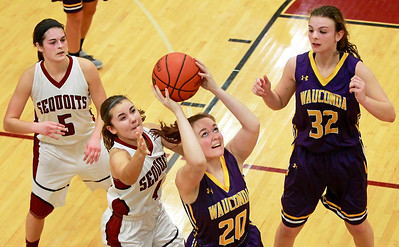 Candace H. Johnson-For Shaw Media Wauconda's Elise Deaver (#20) looks up for a shot against Antioch's Piper Foote (#4)  in the fourth quarter at Antioch Community High School.