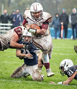 Samson Evans (22) from Prairie Ridge breaks free from Danny Daigle (21) from Cary-Grove for the game winning touchdown during the fourth quarter of their IHSA Class 6A playoff game at Cary-Grove High School on Saturday, November 4, 2017 in Cary, Illinois. The Wolves defeated the Trojans 17-13. John Konstantaras photo for Shaw Media