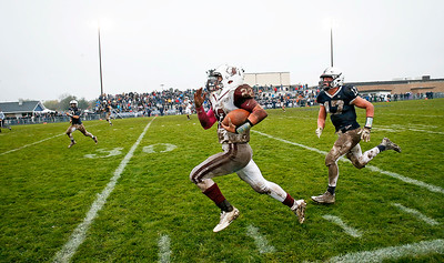 Samson Evans (22) from Prairie Ridge outruns Ben McDonald (17) from Cary-Grove for the game winning touchdown during the fourth quarter of their IHSA Class 6A playoff game at Cary-Grove High School on Saturday, November 4, 2017 in Cary, Illinois. The Wolves defeated the Trojans 17-13. John Konstantaras photo for Shaw Media